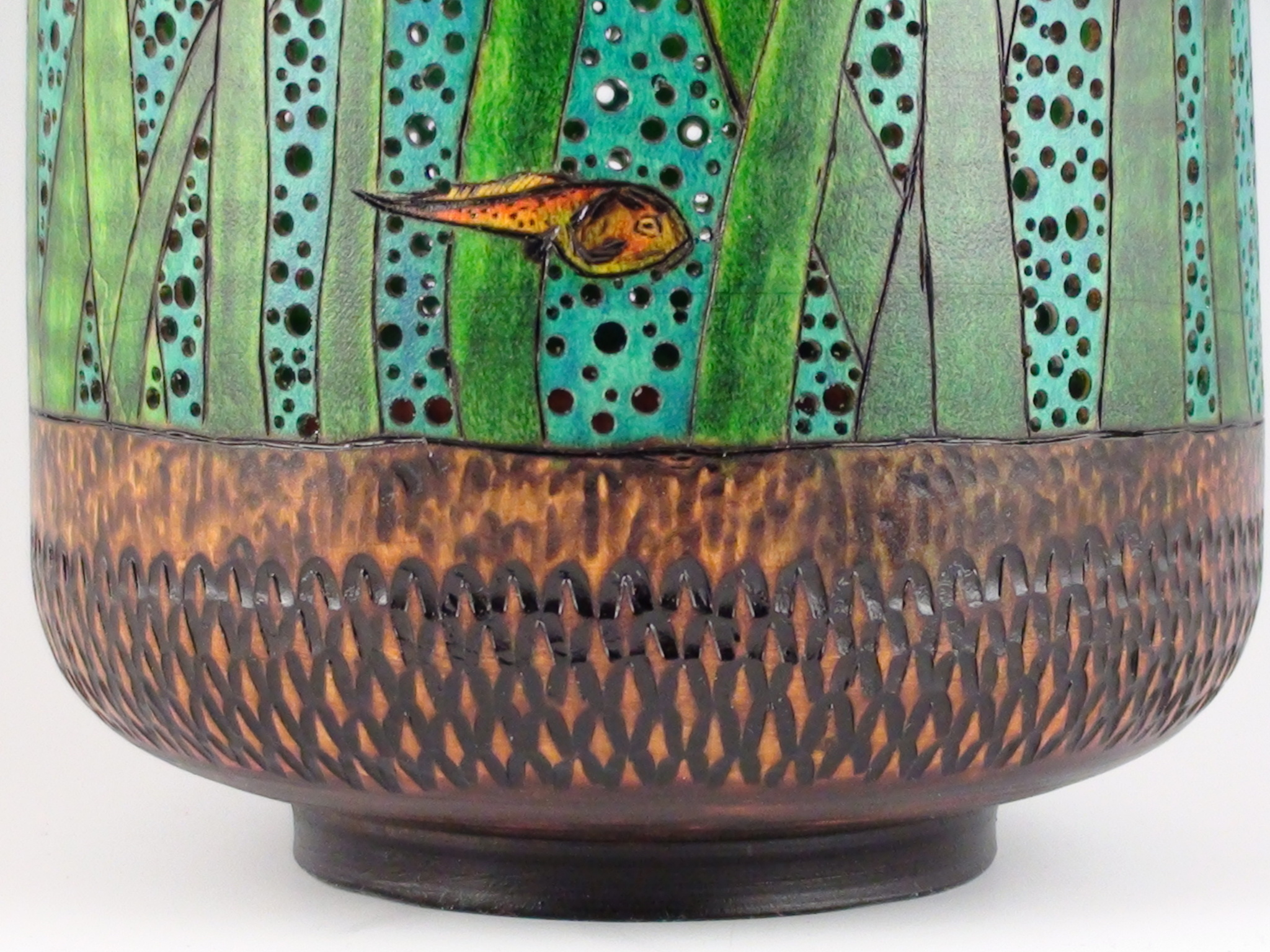 close-up, marsh lake motif on carved, pierced, dyed wooden vessel